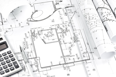 Construction building plans with calculator and pencil Stock Photo