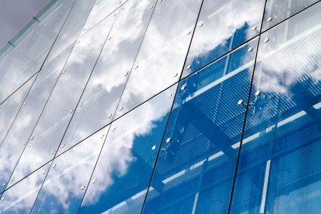 Cloud reflection on glass building photo