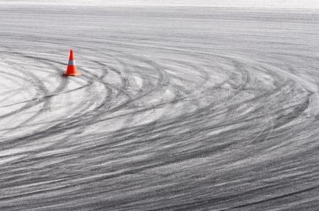 Speeding tire tracks on asphalt photo