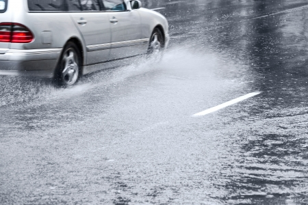 Dangerous conditions on a wet road photo