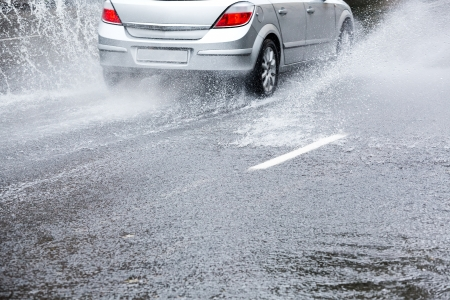 torrential: Car on very wet road