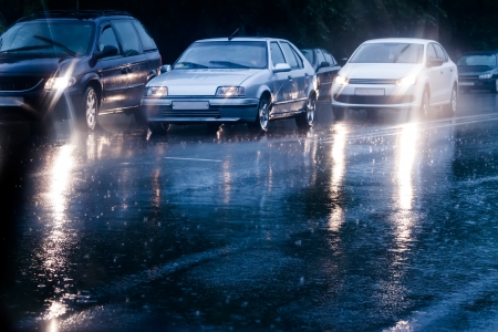 Traffic jam in flooded street photo