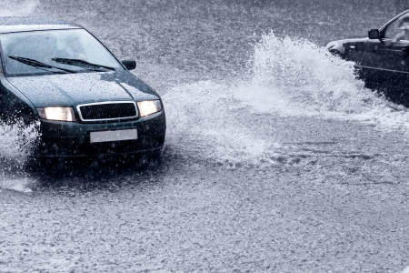 Cars driving through deep puddle photo