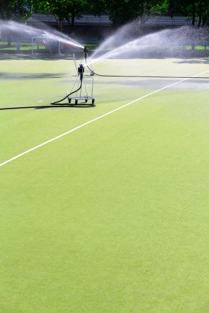 Watering artificial turf on the football stadium  photo
