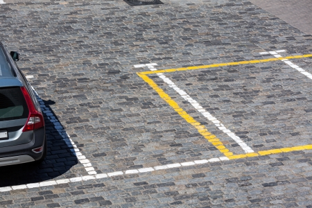 dividing lines: Empty cobbled parking lot and dividing lines Stock Photo