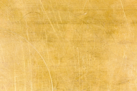 Stained and scratched brass texture background photo