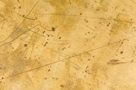 Scratched and stained brass metal background photo