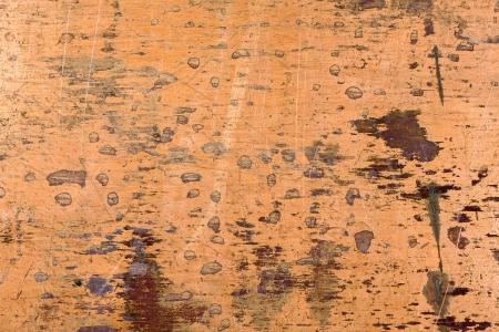 Closeup of brushed brass metal plate photo