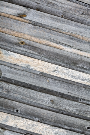 Stained gray planks of wooden wall texture photo