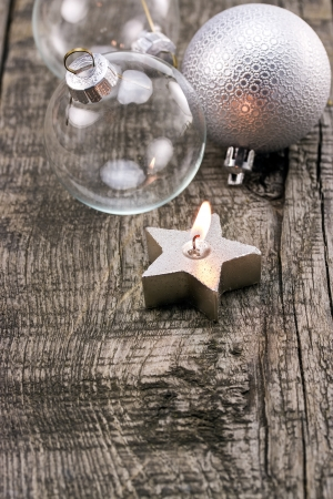 Christmas decorations on old grunge wooden board photo