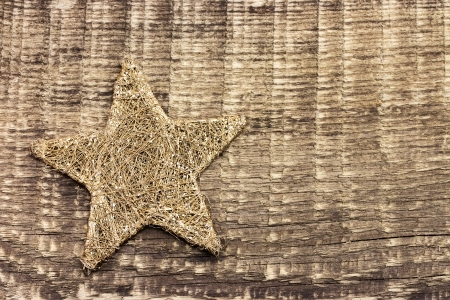 estrellas de navidad: Estrella de la Navidad en tarjeta de madera desgastada