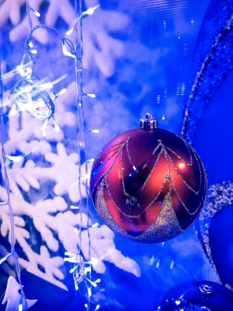 shiny: Red Christmas ball against blue background Stock Photo