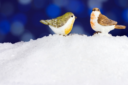 Christmas winter robin figurine on snow photo