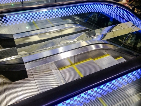 shiny metal: Blue escalator Stock Photo