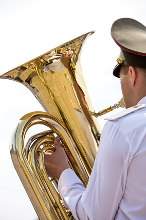 Musician playing a big tuba in military band photo
