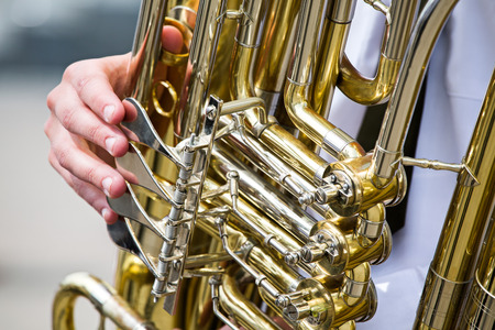 Detail view of valve section of bass tuba photo