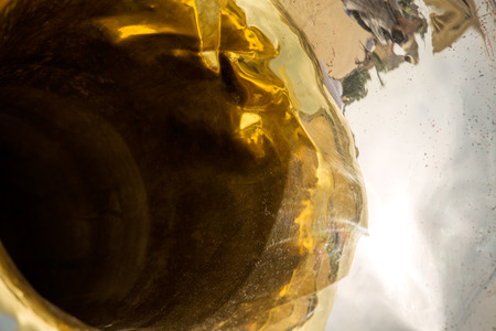Golden brass bass tuba with reflection photo