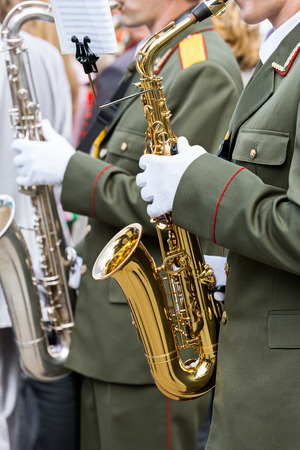 Musician playing his instrument in a military band photo
