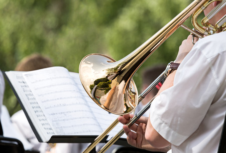 Musician playing the trombone in orchestra