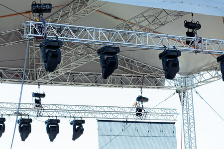 outdoor lighting: Professional lighting equipment high above an outdoor theatrical performance