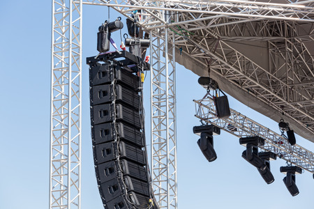 Setting up a stage lighting and sound equipment before the concert