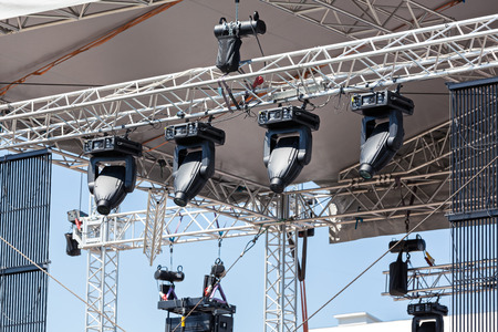 Professional lighting equipment high above an outdoor theatrical performance photo