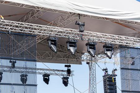 outdoor lighting: Spotlights lighting equipment on outdoor stage before the concert