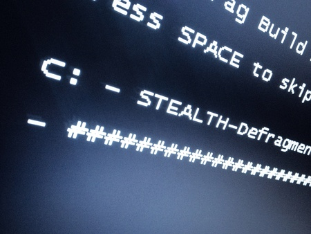 stealth: Stealth defragmentation. Notification on computer monitor.