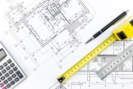 tape measure: Engineering and architecture drawings and work tools - ruler, pencil, calculator, tape measure Stock Photo