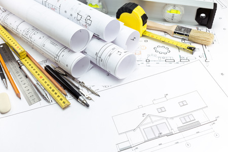 Architectural with technical drawings and work tools photo