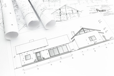 Architectural blueprints of new home and construction plans rolls Archivio Fotografico