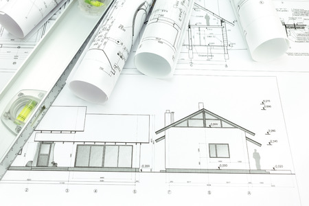 Architectural blueprints of new home and building plans rolls photo