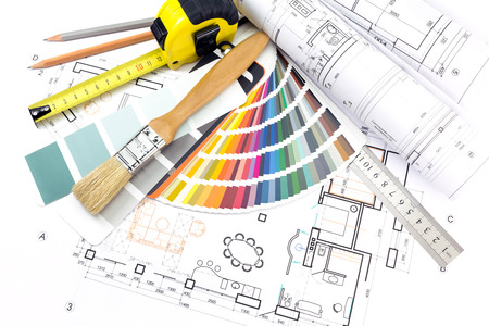Architectural background with technical drawings, color samples and work tools