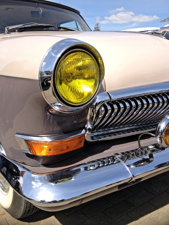 chrome: Retro car with yellow headlights