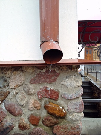 metal: Rain water flowing a metal downspout Stock Photo