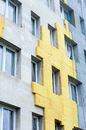 rock wool: Thermal insulation of building facade with rock wool