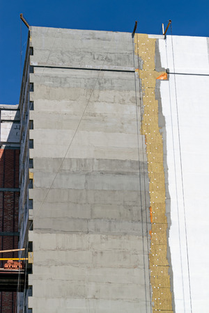 rock wool: Thermal insulation wall of apartment building with mineral rock wool