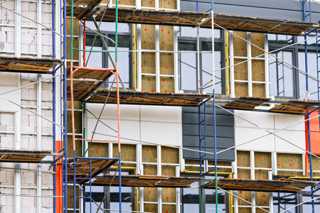 Residential construction in the process of being built with metal scaffolding