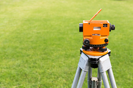 tripod mounted: Construction surveyor equipment theodolite level tool mounted on tripod