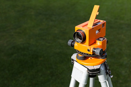 elevation meter: Construction equipment theodolite tool at construction site in summer