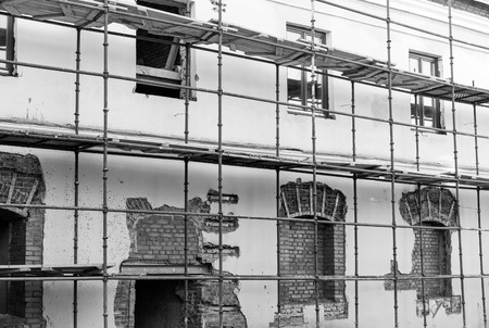 renovate old building facade: Scaffolding around historic building during the renovation