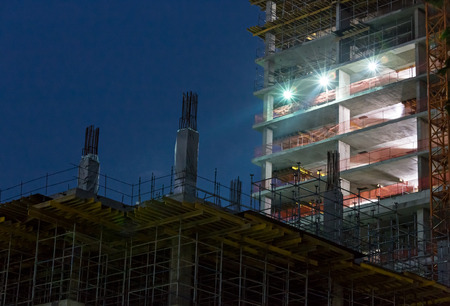 new site: Construction site at night with lights against the dark sky Stock Photo
