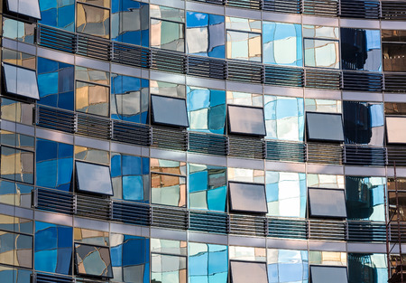 mirrored: Reflection in the windows of modern glass office building