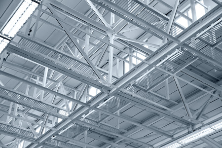 Industrial factory ceiling with roof beam and lights photo