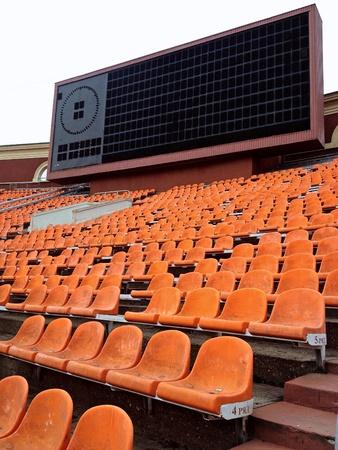 score board: Orange stadium seats with score board