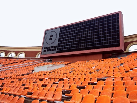 score board: Score board and rows of seats at old football stadium Stock Photo