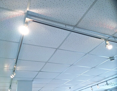 recessed: Accent lighting recessed white track on ceiling above contemporary art exhibition