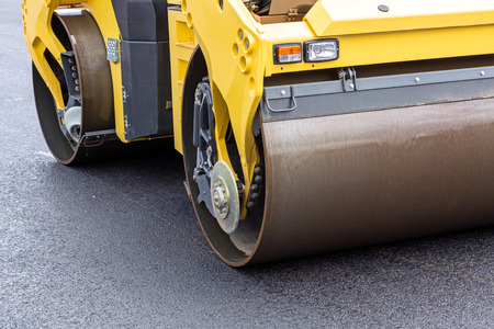 Closeup view of steamroller during works of road repairing photo