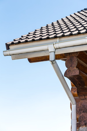 gutter: Corner of wooden house with gutter