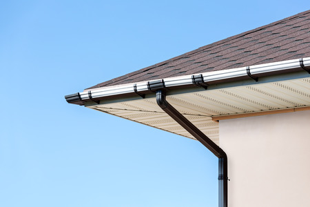 Corner of the house with gutter